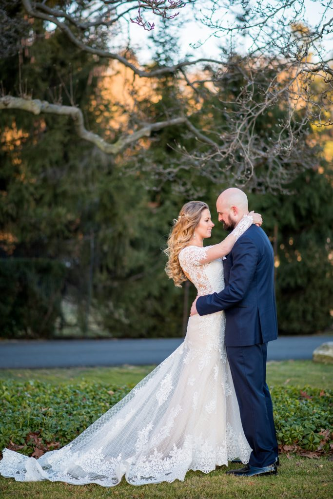 Wedding photos at Sleepy Hollow Country Club for a winter reception in January by Mikkel Paige Photography. A picture of the bride looking into her new husband's eyes during their New York celebration.