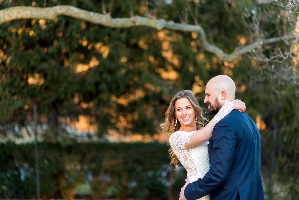 Wedding photos at Sleepy Hollow Country Club for a winter reception in January by Mikkel Paige Photography. A picture of the bride and groom during golden hour of their New York celebration.