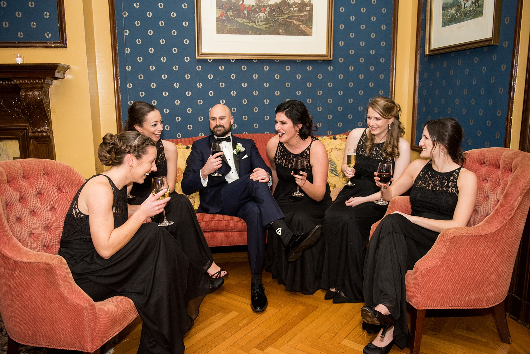 Wedding photos at Sleepy Hollow Country Club for a winter reception in January by Mikkel Paige Photography. The groom shared drinks with the bridal party during this NY winter wedding.