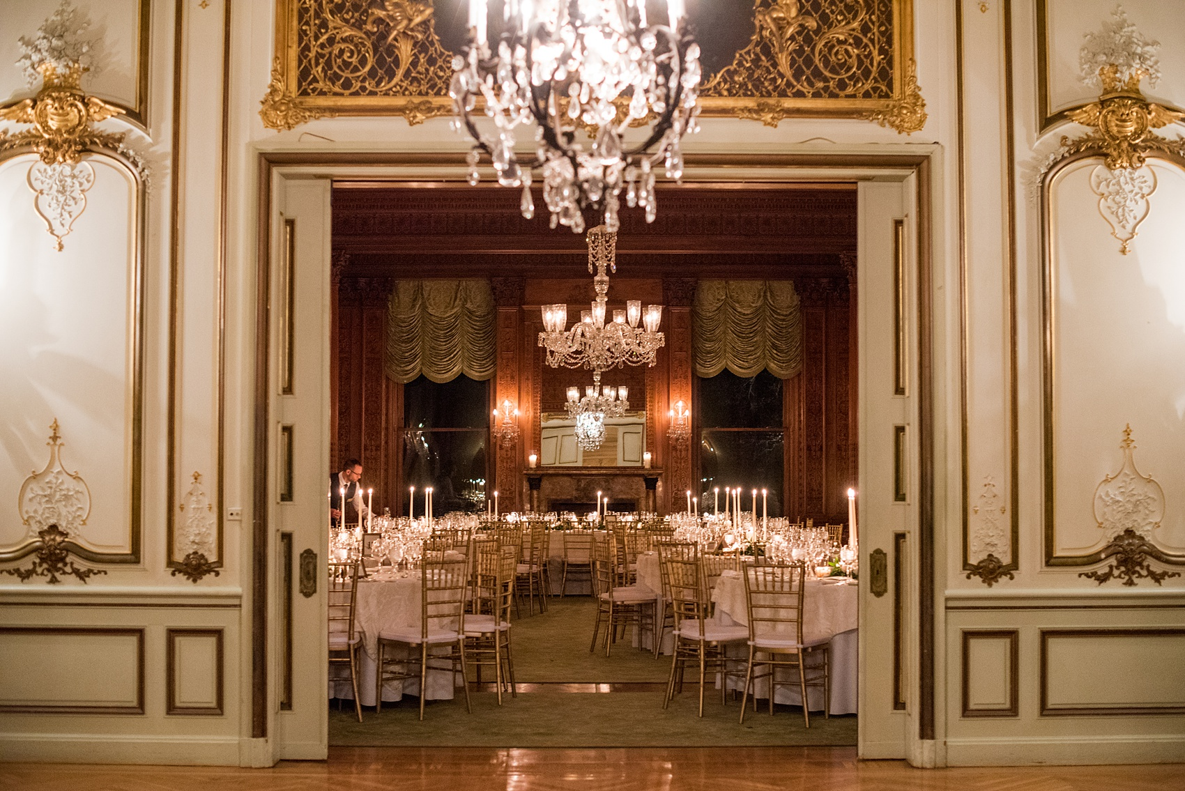 Wedding photos at Sleepy Hollow Country Club for a winter reception in January by Mikkel Paige Photography. Their ornate, European inspired New York winter wedding venue was decorated with gold and white accents.