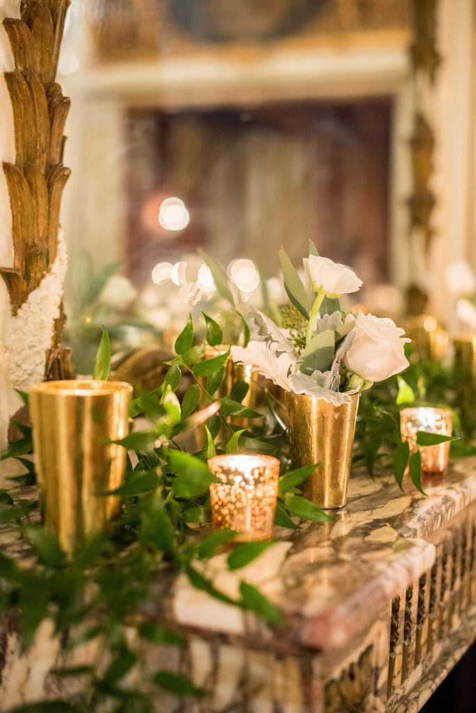 Wedding photos at Sleepy Hollow Country Club for a winter reception in January by Mikkel Paige Photography. Their New York winter wedding venue was decorated with lots of greenery and candlelight.