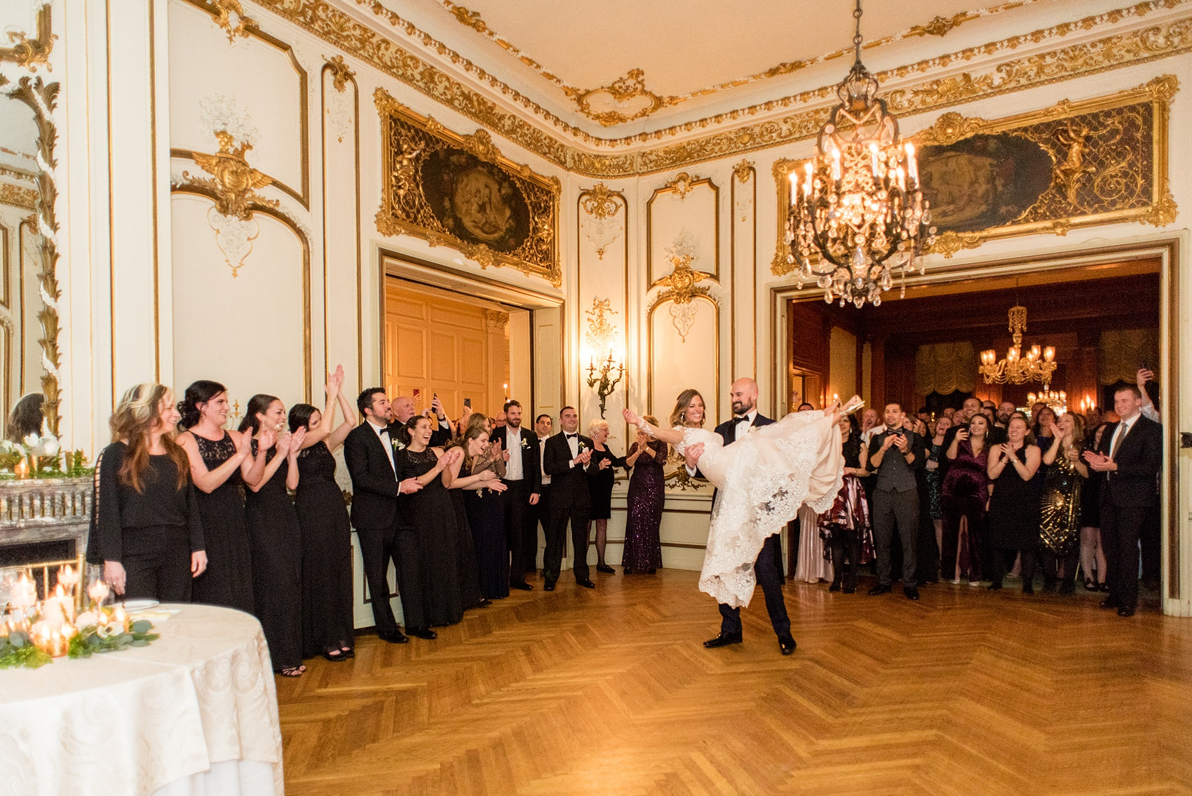 Wedding photos at Sleepy Hollow Country Club for a winter reception in January by Mikkel Paige Photography. They shared their first dance at their NY winter wedding, inside the ornate center room of the venue and ended with the groom lifting the bride for a twirl!
