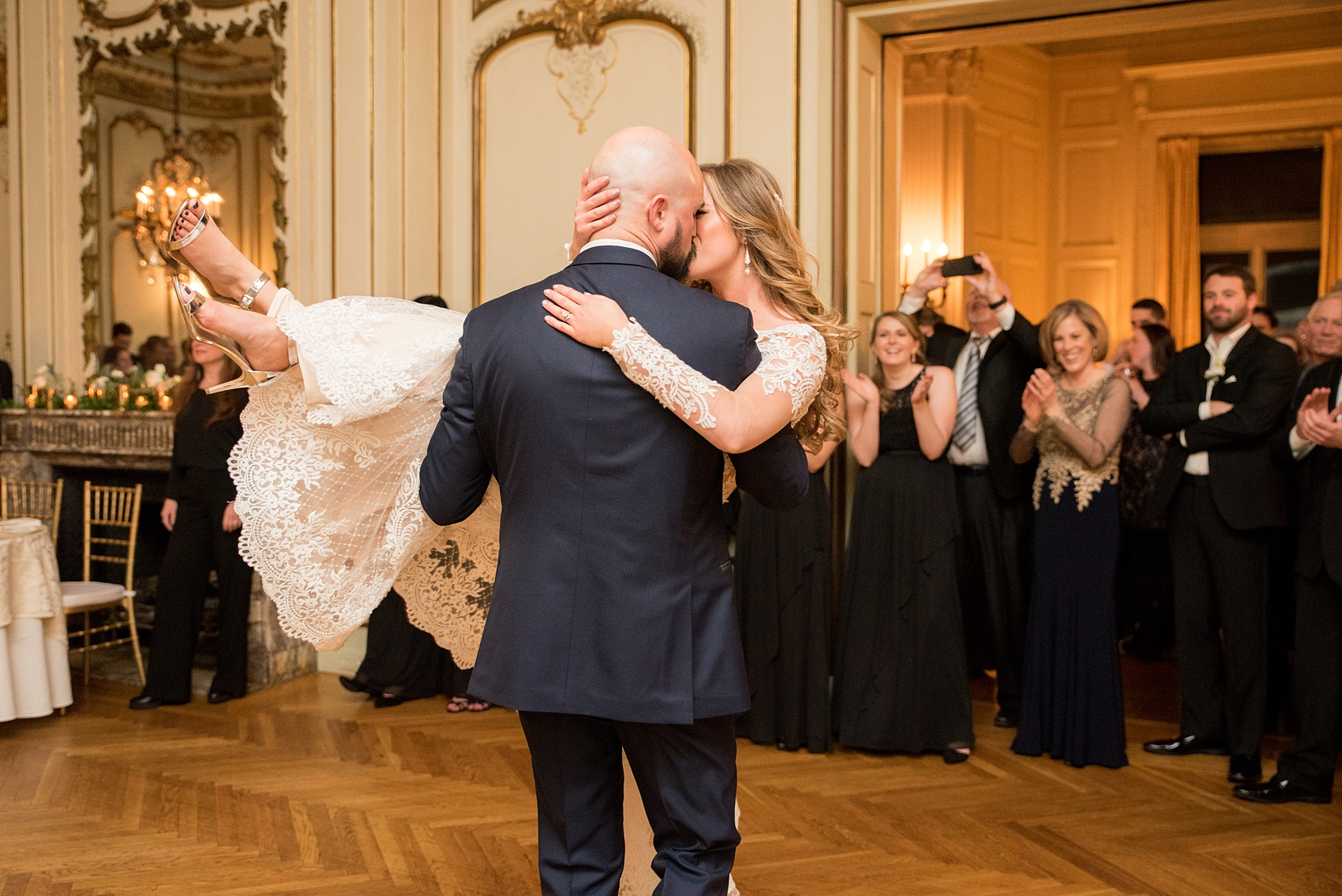 Wedding photos at Sleepy Hollow Country Club for a winter reception in January by Mikkel Paige Photography. They shared their first dance at their NY winter wedding, inside the ornate center room of the venue.