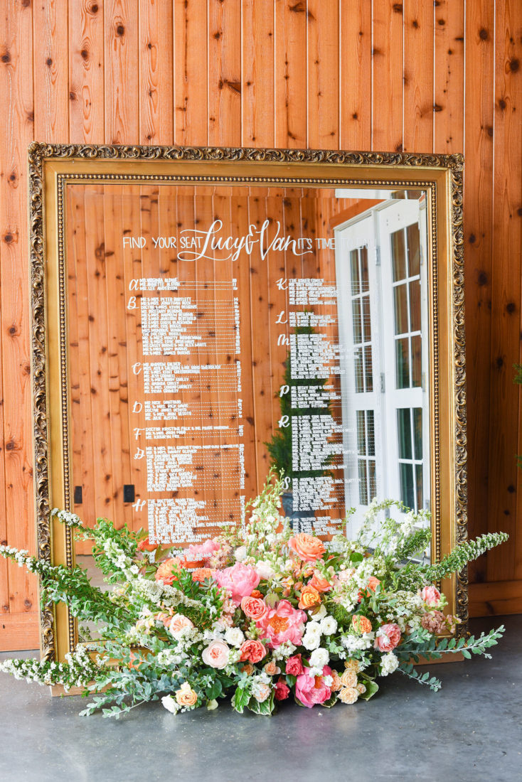 Charlottesville wedding photos at the Lodge at Mount Ida Farm by Mikkel Paige Photography. This Virginia venue is perfect for brides and grooms looking for a beautiful farm reception space. It's green, romantic, and easy to dress up with flowers or keep simple. Custom mirror seating chart was decorated with flowers by Meristem Floral and written by Mason Dixon Designs. Click through for the complete post from this May event! #Charlottesville #mountidafarm #lodgeatmountida #CharlottesvilleVA #CharlottesvilleVirginia #Charlottesvillewedding #Charlottesvilleweddingphotographer #mikkelpaige #MeristemFloral #VivaLEvent #mirrorsign #seatingchart #seatingsign #masondixondesigns #calligraphy