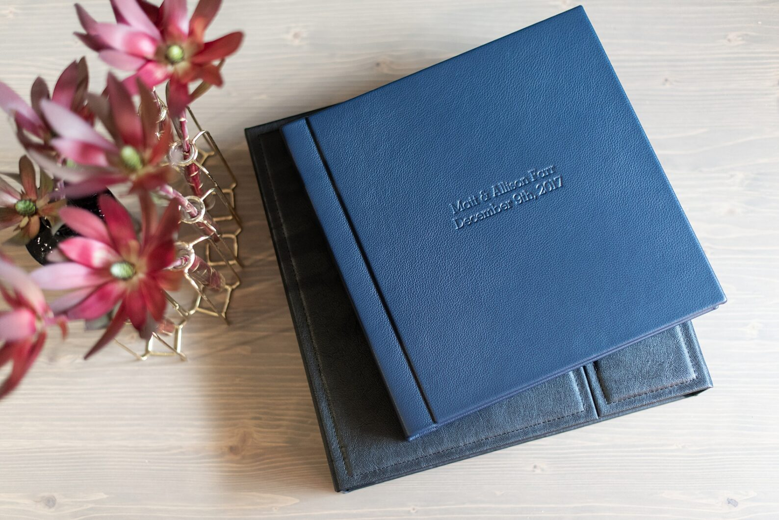 Navy blue leather fine art wedding album from Mikkel Paige Photography, with photos from a snowy winter wedding at The Carolina Inn, in North Carolina. This beatiful, historic venue in Chapel Hill is perfect for outdoor and indoor events no matter if it's spring, summer or fall too. Click through to see more pictures of this couples gorgeous family heirloom keepsakes! #mikkelpaige #carolinainnweddingphotos #carolinainn #leatheralbum #weddingalbum #chapelhill