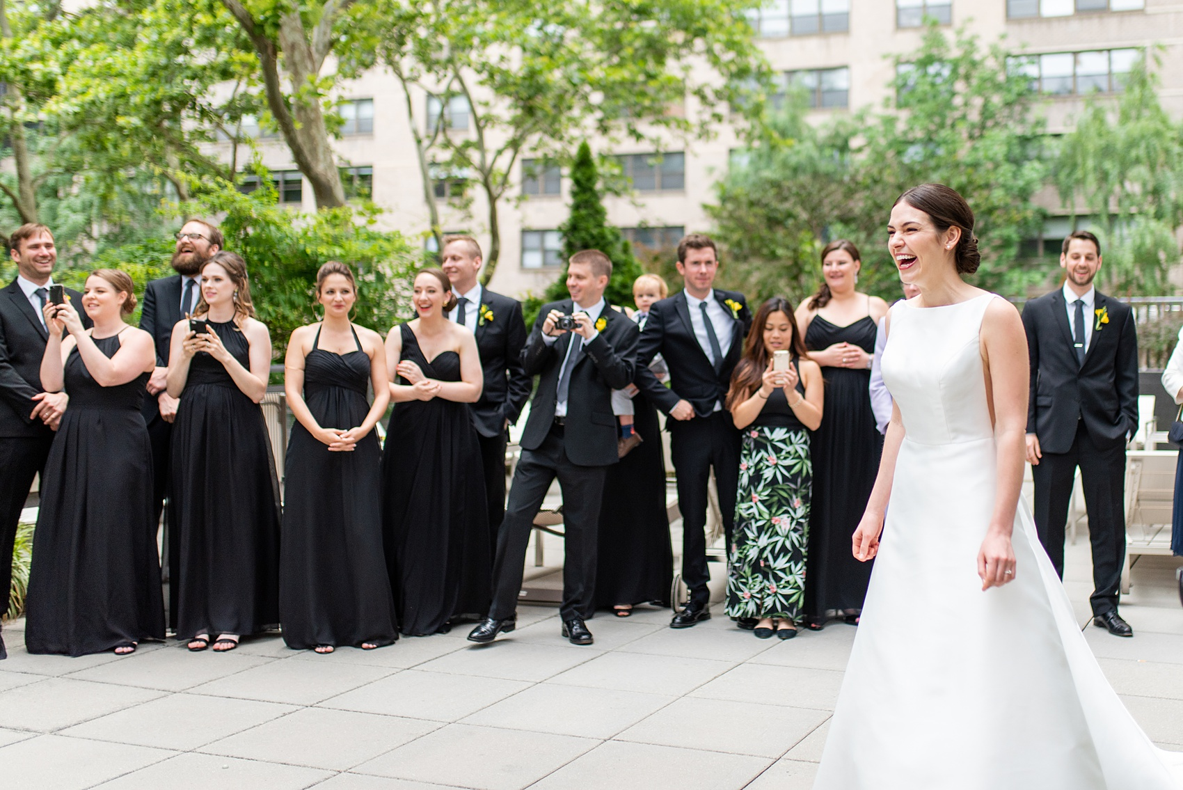 Manhattan Central Park wedding photos by Mikkel Paige Photography at Loeb Boathouse venue. These summer ceremony and reception pictures show a timeless couple having fun at their colorful day with guests who traveled in from abroad. The bride and groom did their first look on the Upper West Side...click through for the complete post! #CentralParkWeddingVenues #NYCweddingphotographer #NYCwedding