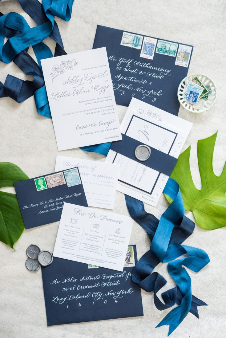 Casa de Campo in the Dominican Republic is a great location for a destination wedding. It's in La Romana, an hour from Punta Cana, and is an all inclusive resort with Minitas beach and mountains view. It's a beautiful venue, evidenced by these pictures by Mikkel Paige Photography. Click through for detail ideas like this blue invitation set with custom calligraphy! Planning by @theeventeur, invitation by @agianetti of Write Pretty for Me. #mikkelpaige #bluewedding #weddinginvitation #letterpress #waxseal #customcalligraphy #vintagestamps #silkribbons