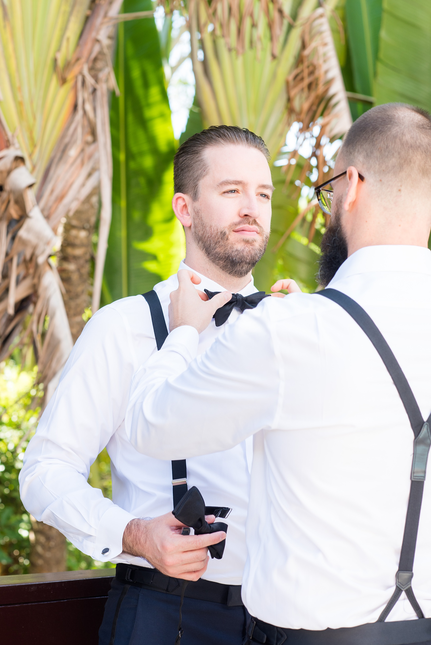 La Romana is an hour from Punta Cana and home to an incredible, all inclusive resort with beautiful Minitas beach and mountain view in the Dominican Republic. It's a great location for a destination wedding, which these pictures of the groomsmen getting ready with the groom, by Mikkel Paige Photography, prove! Click through for more Casa de Campo wedding photography and ideas! Planning by @theeventeur. #GettingReady #destinationwedding #mikkelpaige #groomsmen #groom