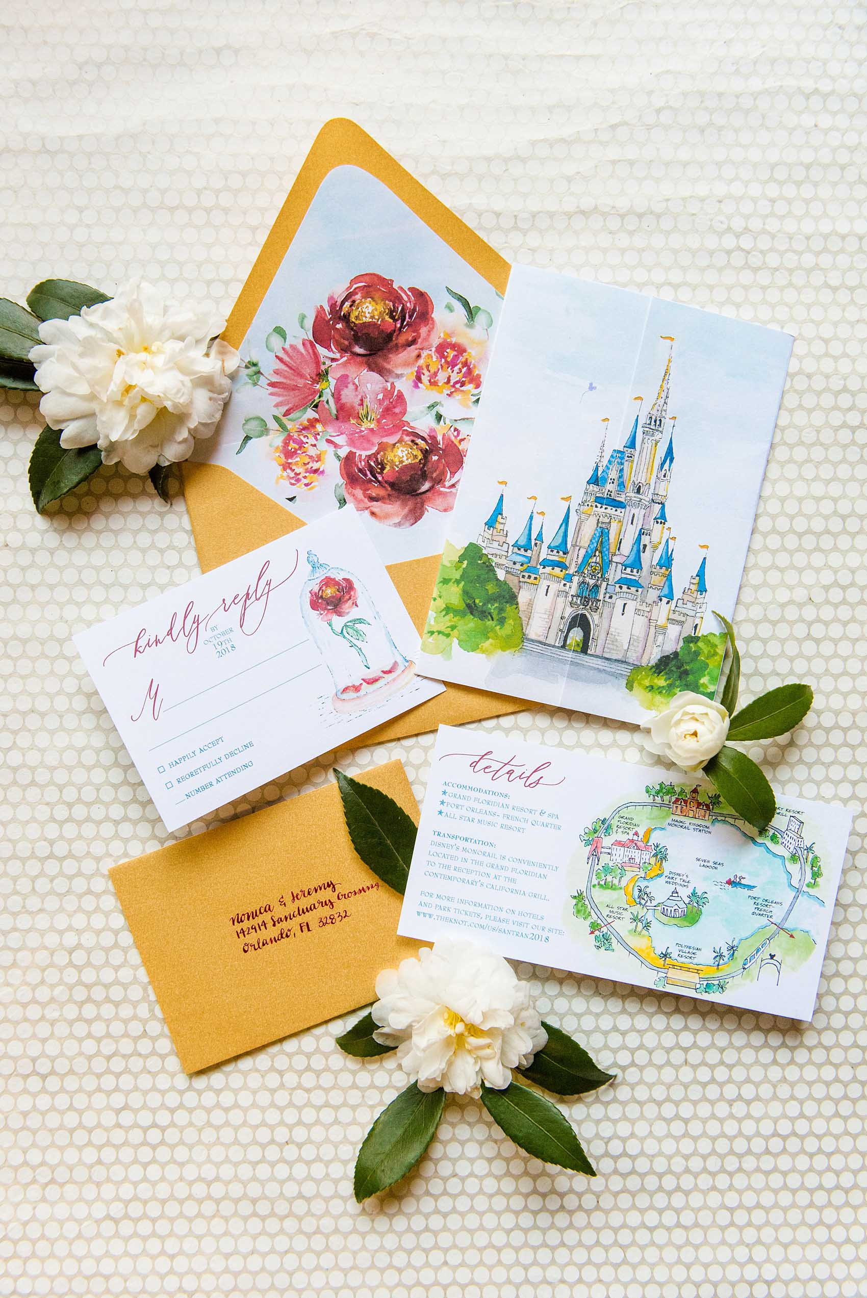 Photographs of a Walt Disney World wedding by Mikkel Paige Photography will give you ideas for a tasteful Beauty and the Beast theme. The awesome invitation had a custom watercolor by Watercolor Design Studio of the couple's dog, Cinderella's castle, and the Seven Seas Lagoon. The bride and groom managed beautiful details for their dream ceremony and reception even on a small budget. #disneywedding #disneybride #waltdisneyworld #DisneyWorldWedding #watercolorinvitation #disneyillustration