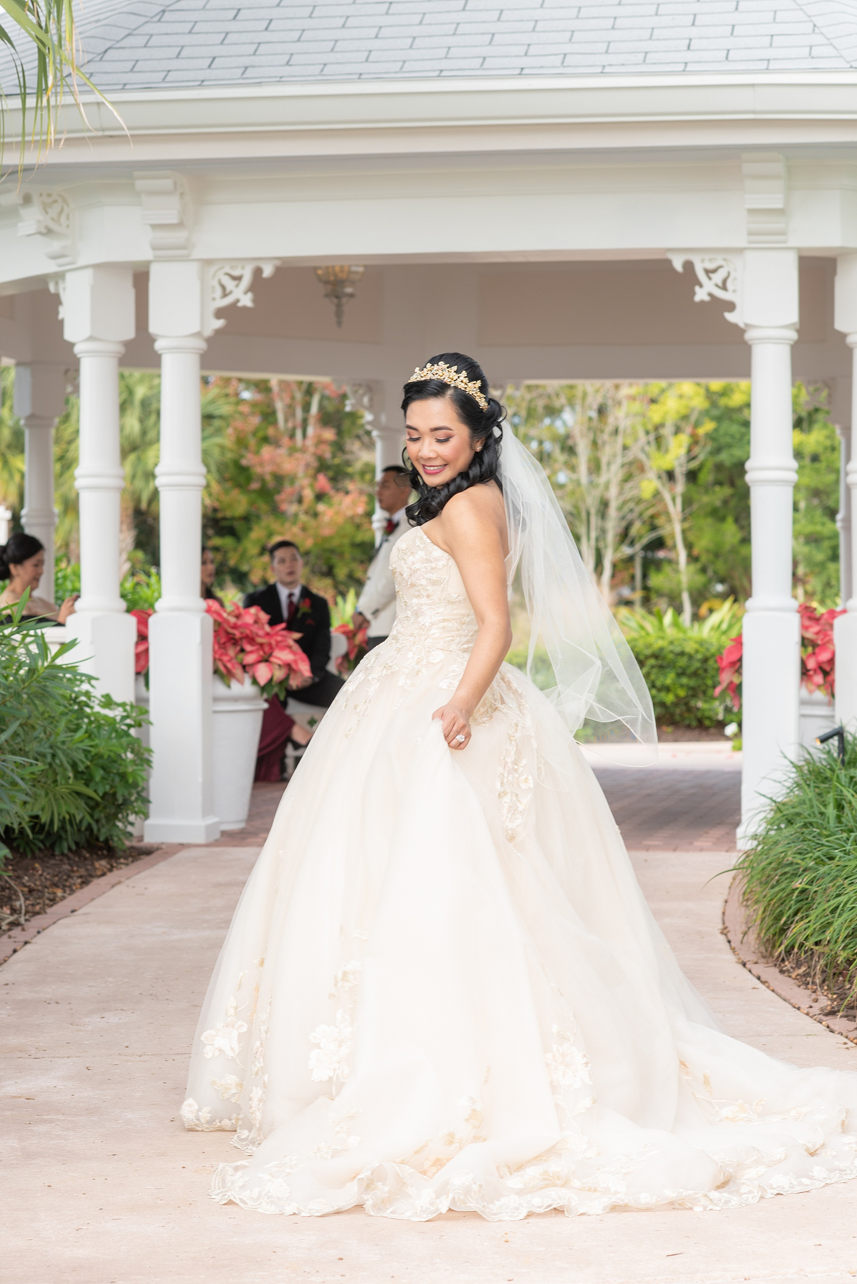 Photographs of a Walt Disney World bride by Mikkel Paige Photography. As a lover of Beauty and the Beast, the bride wove details from the classic Disney film into her wedding. Her beautiful rose embroidered dress was befitting of a princess. She got ready for her day at the dream resort, the Grand Floridian. Her hair was twisted into a fun, rose bun. #disneywedding #disneybride #waltdisneyworld #DisneyWorldWedding