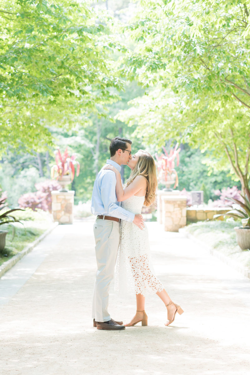 Duke Gardens engagement photos in Durham, North Carolina, by Mikkel Paige Photography. Trees with leaves in full bloom during spring reveal themselves for a May session. #DurhamPhotographer #DurhamWeddingPhotographer #SarahPDukeGardens #DukeGardens #DurhamEngagementSession