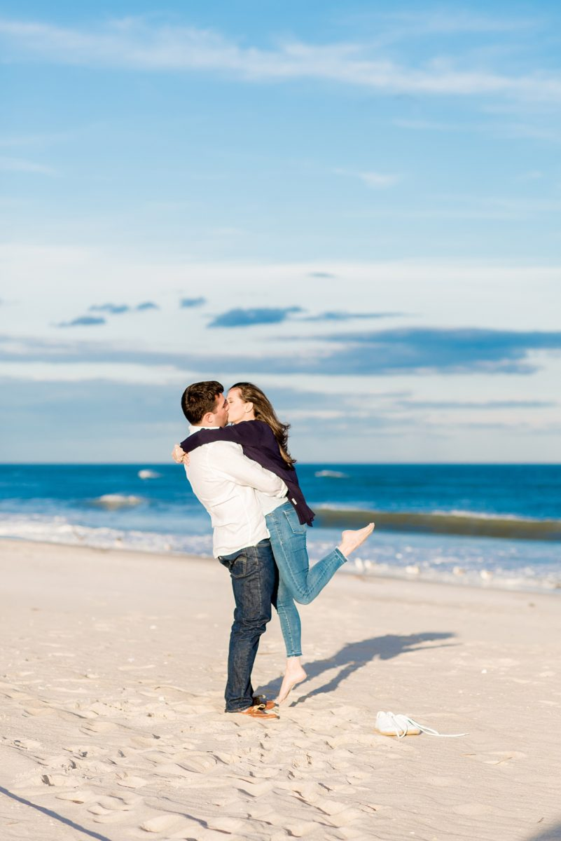 Beautiful Long Island engagement photos on the beach with a lighthouse. Mikkel Paige Photography captured the couple at Robert Moses state park in New York, just 40 minutes from NYC. #mikkelpaige #LongIslandEngagement #LongIslandBeachEngagement #Beachweddingphotos #LongIslandphotographer #LongIslandWeddingPhotographer