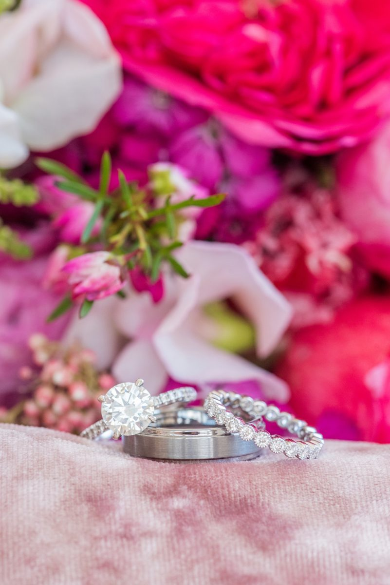 A beautiful spring wedding in downtown Raleigh, North Carolina, at the event venue, The Stockroom at 230 and The Glass Box. Their photographer, Mikkel Paige Photography, captured beautiful ring detail images and wedding portraits, and bridal pictures of their hot pink and aqua blue colors. #MikkelPaige #DowntownRaleigh #RaleighWedding #RaleighVenue #TheStockroomat230