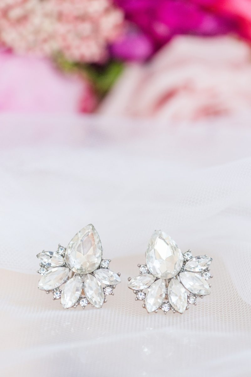 A beautiful spring wedding in downtown Raleigh, North Carolina, at the event venue, The Stockroom at 230 and The Glass Box. Their photographer, Mikkel Paige Photography, captured beautiful detail images of the bride's earrings for a pink palette wedding. #MikkelPaige #DowntownRaleigh #RaleighWedding #RaleighVenue #TheStockroomat230 #weddingearrings