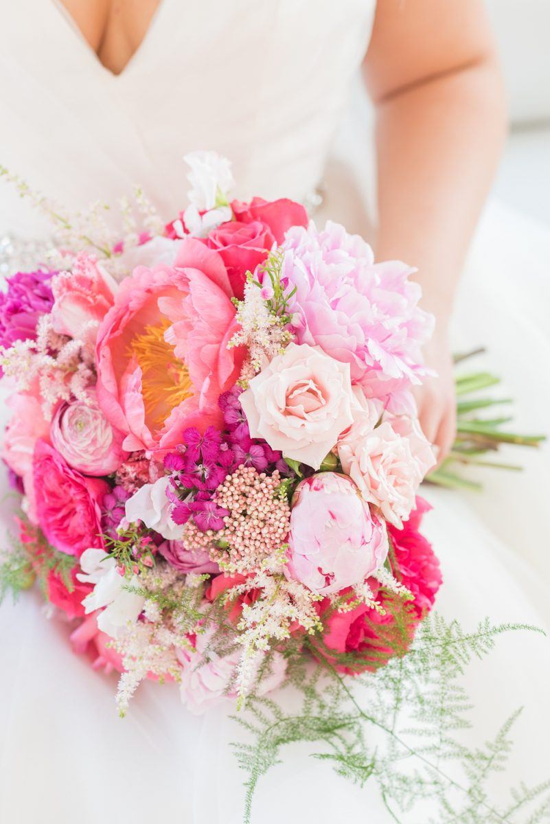 A beautiful spring wedding in Raleigh, North Carolina, at the event venue, The Stockroom at 230 and The Glass Box. Their photographer, Mikkel Paige Photography, captured inspiring bride and groom wedding portraits at the capital building downtown. Their hot pink and aqua colors and peony bouquet perfect for May. #MikkelPaige #DowntownRaleigh #RaleighWedding #RaleighVenue #TheStockroomat230 #theenglishgardenraleigh