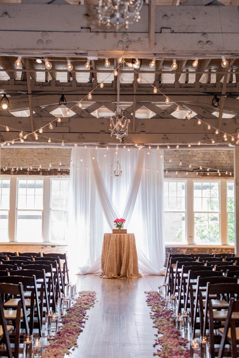 Indoor spring wedding ceremony at the event venue The Stockroom at 230 in Raleigh, North Carolina. Their photographer, Mikkel Paige Photography, captured the bride and groom's vows in this historic building near the capital downtown. #MikkelPaige #DowntownRaleigh #RaleighWedding #RaleighVenue #TheStockroomat230 #weddingceremony #indoorweddingceremony