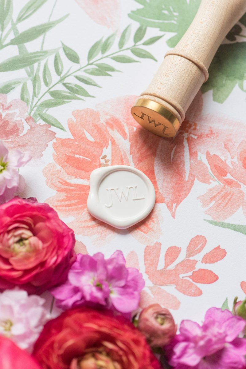 Floral watercolor wedding stationery and wax seal for invitations for a spring wedding in downtown Raleigh, North Carolina at the event venue The Stockroom at 230. Their photographer, Mikkel Paige Photography, captured this lay flat of their hot pink and aqua watercolor by @OneandOnlyPaper and white monogram wax seal. #MikkelPaige #DowntownRaleigh #RaleighWedding #RaleighVenue #TheStockroomat230 #floralwatercolorinvitation #weddinginvitation #oopaper #oneandonlypaper #layflatphotography #waxseal