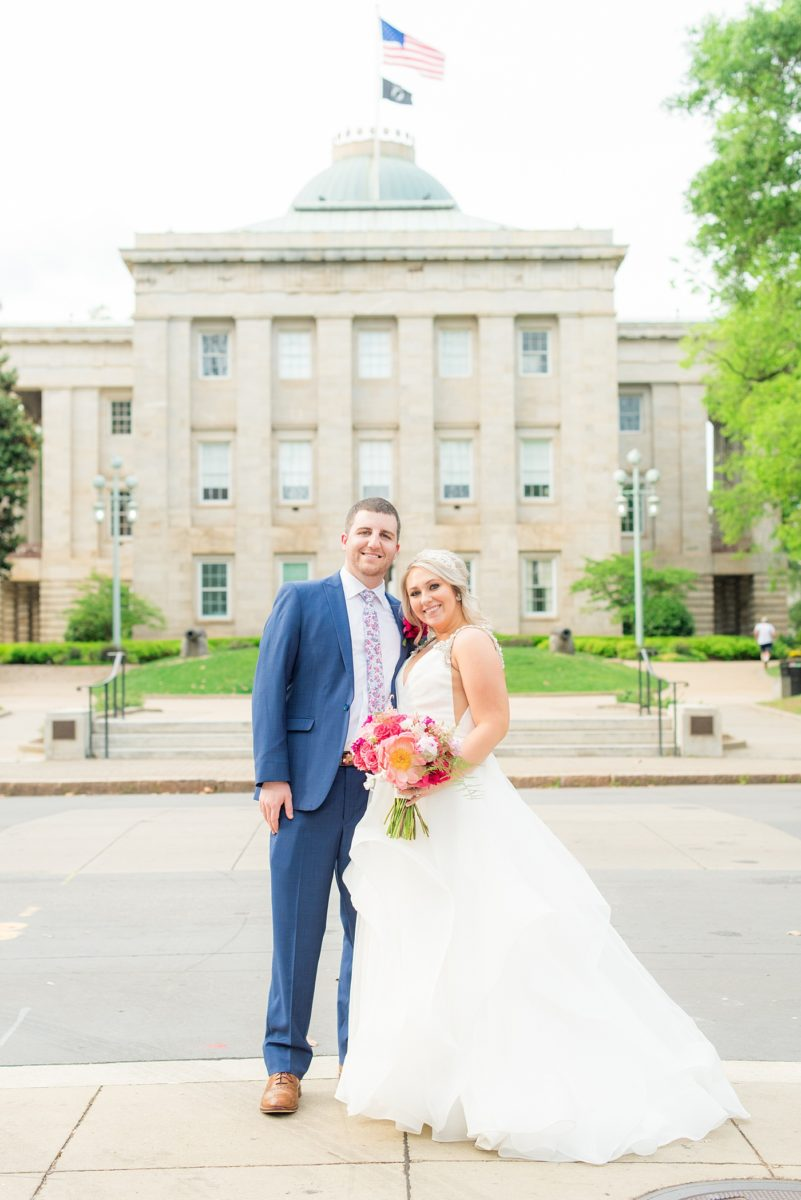 Beautiful spring wedding in downtown Raleigh, North Carolina, at the event venue The Stockroom at 230 and The Glass Box. Their photographer, Mikkel Paige Photography, captured inspiring bride and groom portraits at the capital building with a hot pink peony bouquet by The English Garden. #MikkelPaige #DowntownRaleigh #RaleighWedding #RaleighVenue #TheStockroomat230 #hayleypaige #bridestyle