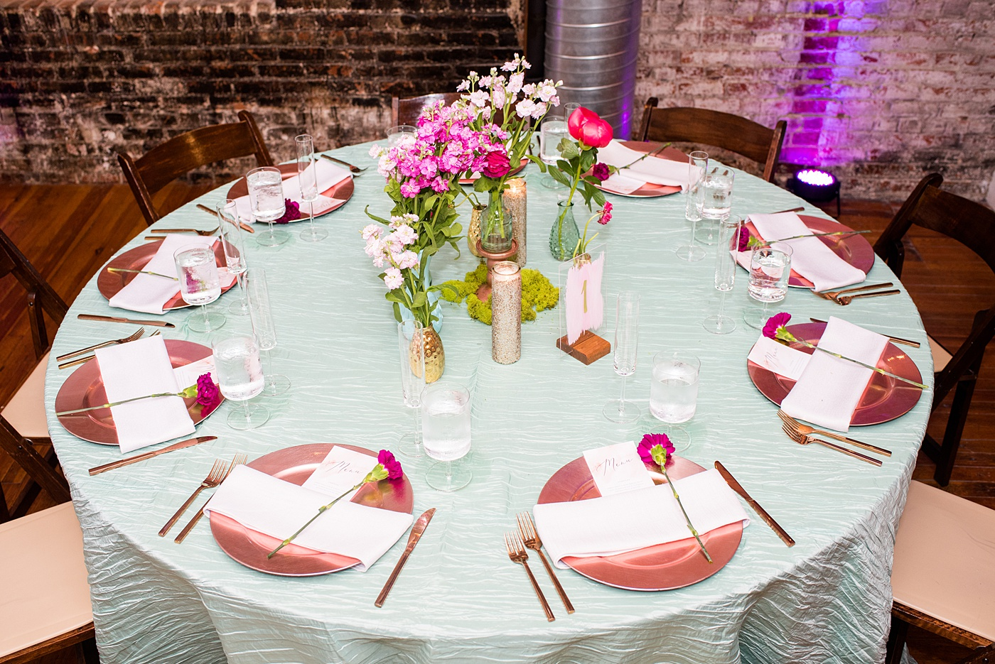 A beautiful spring wedding in downtown Raleigh, North Carolina, at the event venue The Stockroom at 230. Mikkel Paige Photography, their photographer, captured inspiring reception pictures of their hot pink and aqua blue colors. #MikkelPaige #DowntownRaleigh #RaleighWedding #RaleighVenue #TheStockroomat230 #weddingreception