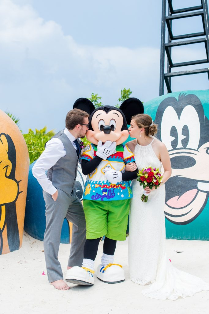 Disney Cruise Line destination wedding photos on Castaway Cay and the Disney Dream ship by Mikkel Paige Photography. This fairy tale wedding made the bride and groom's dream come true to get married in a fun location, spotlighting their love for Disney. Their ceremony was on the beach with the ship in the distance and aqua water nearby in the Bahamas and Mickey Mouse as a special guest. #mikkelpaige #disneywedding #disneyfairytalewedding #disneycruiseline #disneycruiselinewedding #disneydream #cruisewedding #mickeymouse