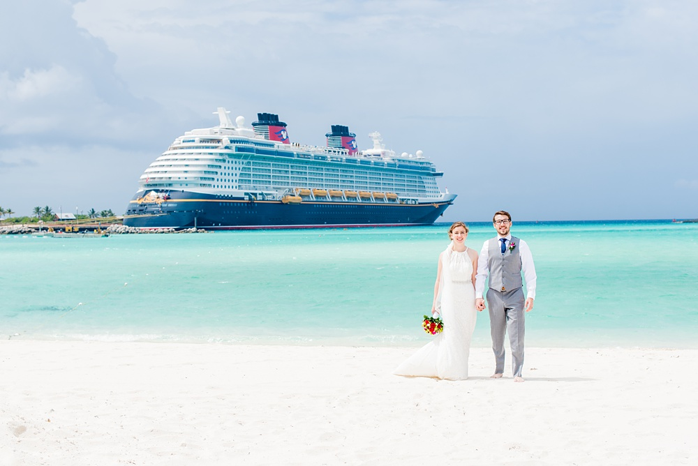 Disney Cruise Line wedding photos on Castaway Cay and the Disney Dream ship by Mikkel Paige Photography. This fairy tale wedding make the bride and groom's dream come true to get married in a fun location, spotlighting their love for the brand. #mikkelpaige #disneywedding #disneyfairytalewedding #disneycruiseline #disneycruiselinewedding #disneydream #cruisewedding #disneyweddingpackage