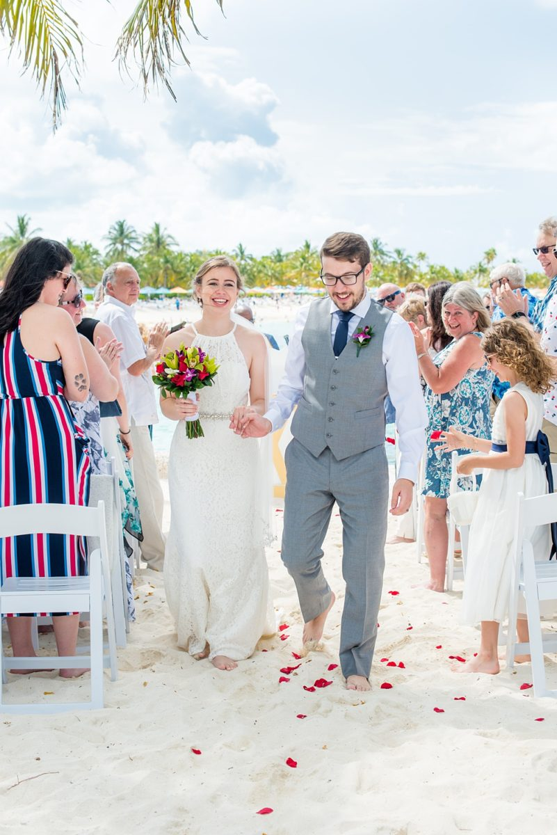 Disney Cruise Line destination wedding photos on Castaway Cay and the Disney Dream ship by Mikkel Paige Photography. This fairy tale wedding make the bride and groom's dream come true to get married in a fun location, spotlighting their love for the brand. Their ceremony was on the beach with the ship in the distance and aqua water nearby in the Bahamas. #mikkelpaige #disneywedding #disneyfairytalewedding #disneycruiseline #disneycruiselinewedding #disneydream #cruisewedding