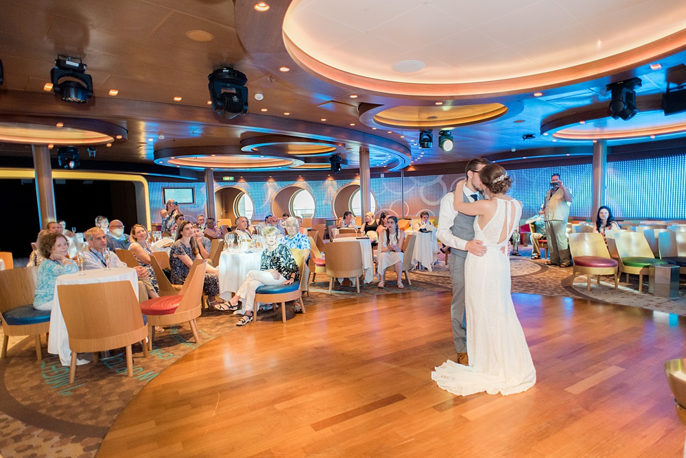 Disney Cruise Line destination wedding photos on Castaway Cay and the Disney Dream ship by Mikkel Paige Photography. This fairy tale wedding make the bride and groom's dream come true to get married in a fun location, spotlighting their love for the brand. Their reception was in the D Lounge with Fairy Tale Celebration champagne and a white fondant cake. #mikkelpaige #disneywedding #disneyfairytalewedding #disneycruiseline #disneycruiselinewedding #disneydream #cruisewedding