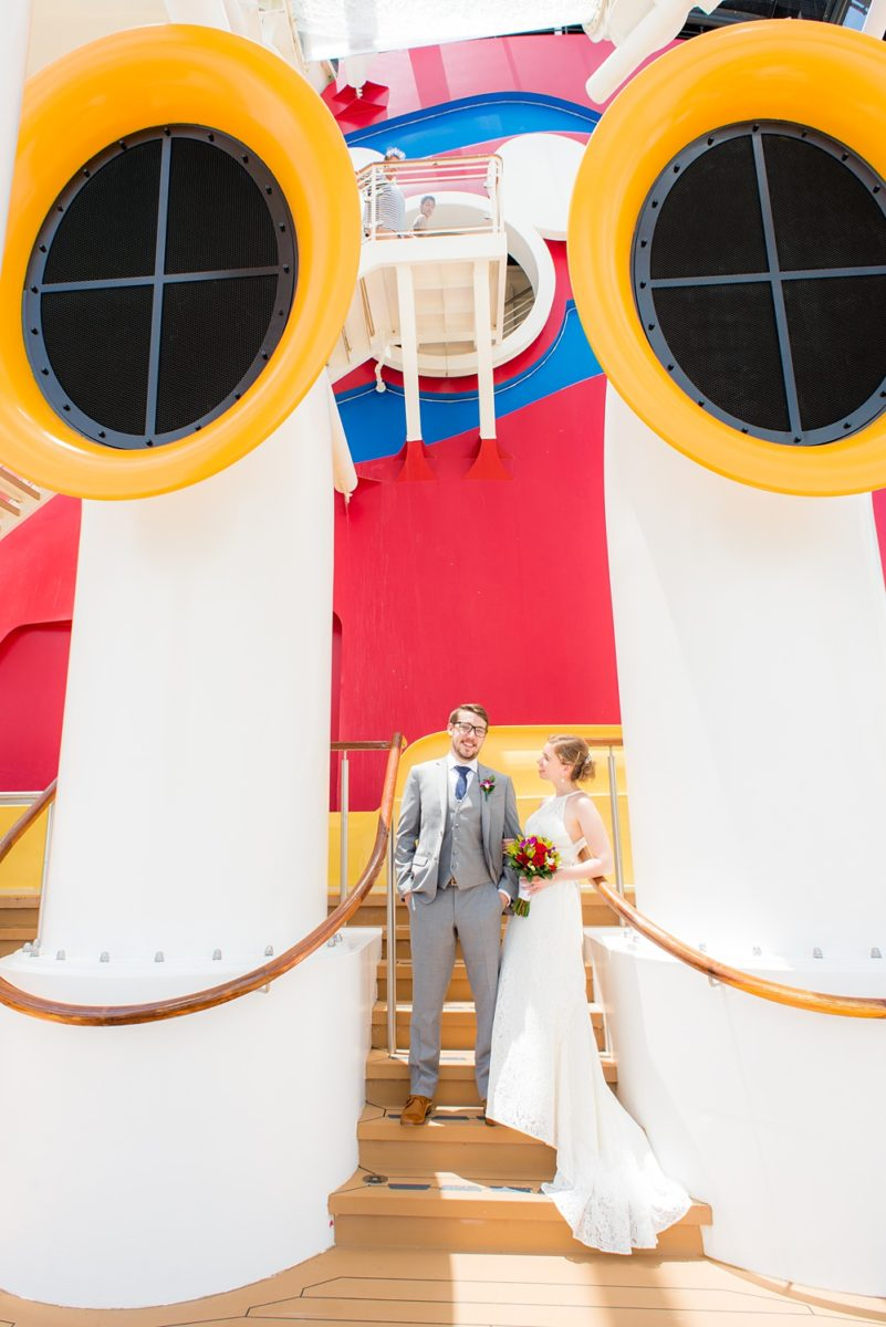 Disney Cruise Line destination wedding photos on Castaway Cay and the Disney Dream ship by Mikkel Paige Photography. This fairy tale wedding make the bride and groom's dream come true to get married in a fun location, spotlighting their love for the brand. #mikkelpaige #disneywedding #disneyfairytalewedding #disneycruiseline #disneycruiselinewedding #disneydream #cruisewedding #velvetringbox
