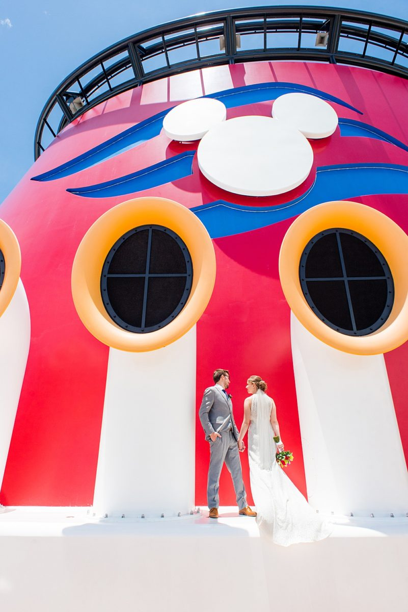 Disney Cruise Line destination wedding photos on Castaway Cay and the Disney Dream ship by Mikkel Paige Photography. This fairy tale wedding make the bride and groom's dream come true to get married in a fun location, spotlighting their love for the brand. #mikkelpaige #disneywedding #disneyfairytalewedding #disneycruiseline #disneycruiselinewedding #disneydream #cruisewedding