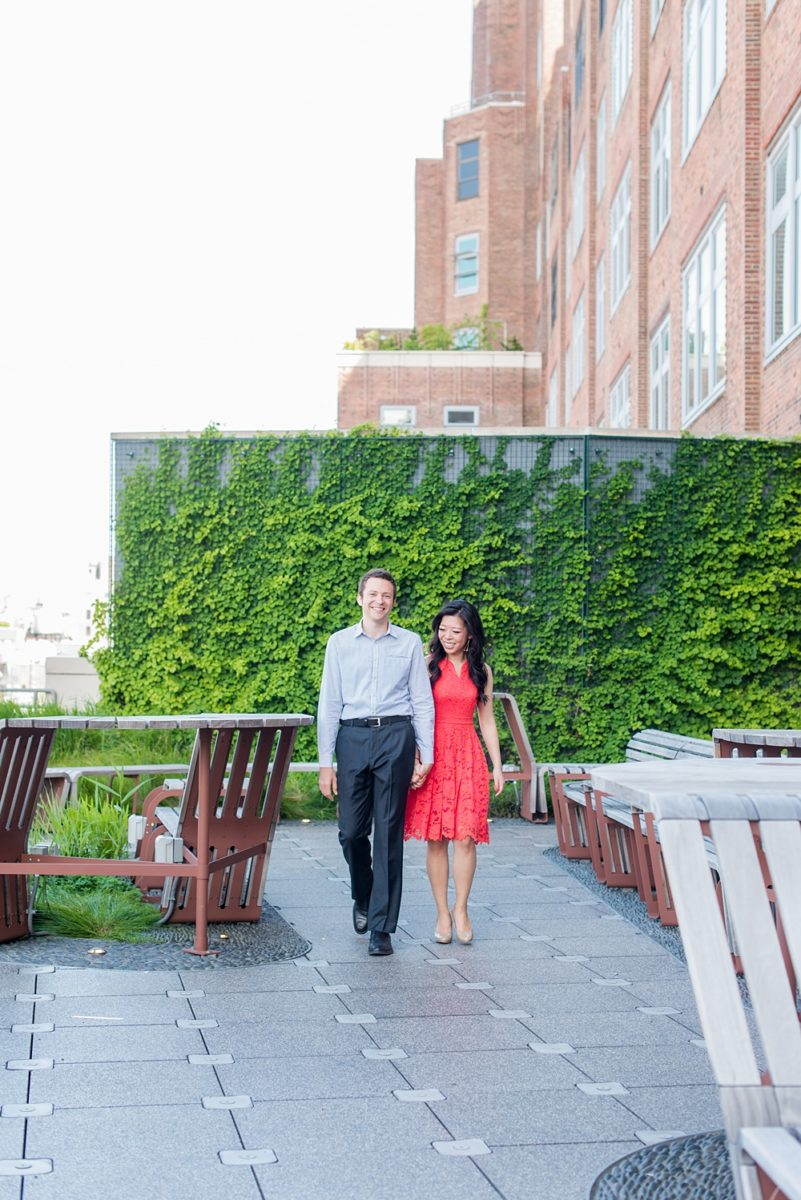 New York City pictures with a beautiful, fun couple with modern style. From a classic round diamond ring to sweet kisses with the Manhattan Skyline, Mikkel Paige Photography took them around western, lower NYC photographing their love at Google headquarters and Washington Square Park for engagement photos. #MikkelPaige #NYCengagementphotos #NewYorkCityEngagementPhotos #NYCengagementpictures