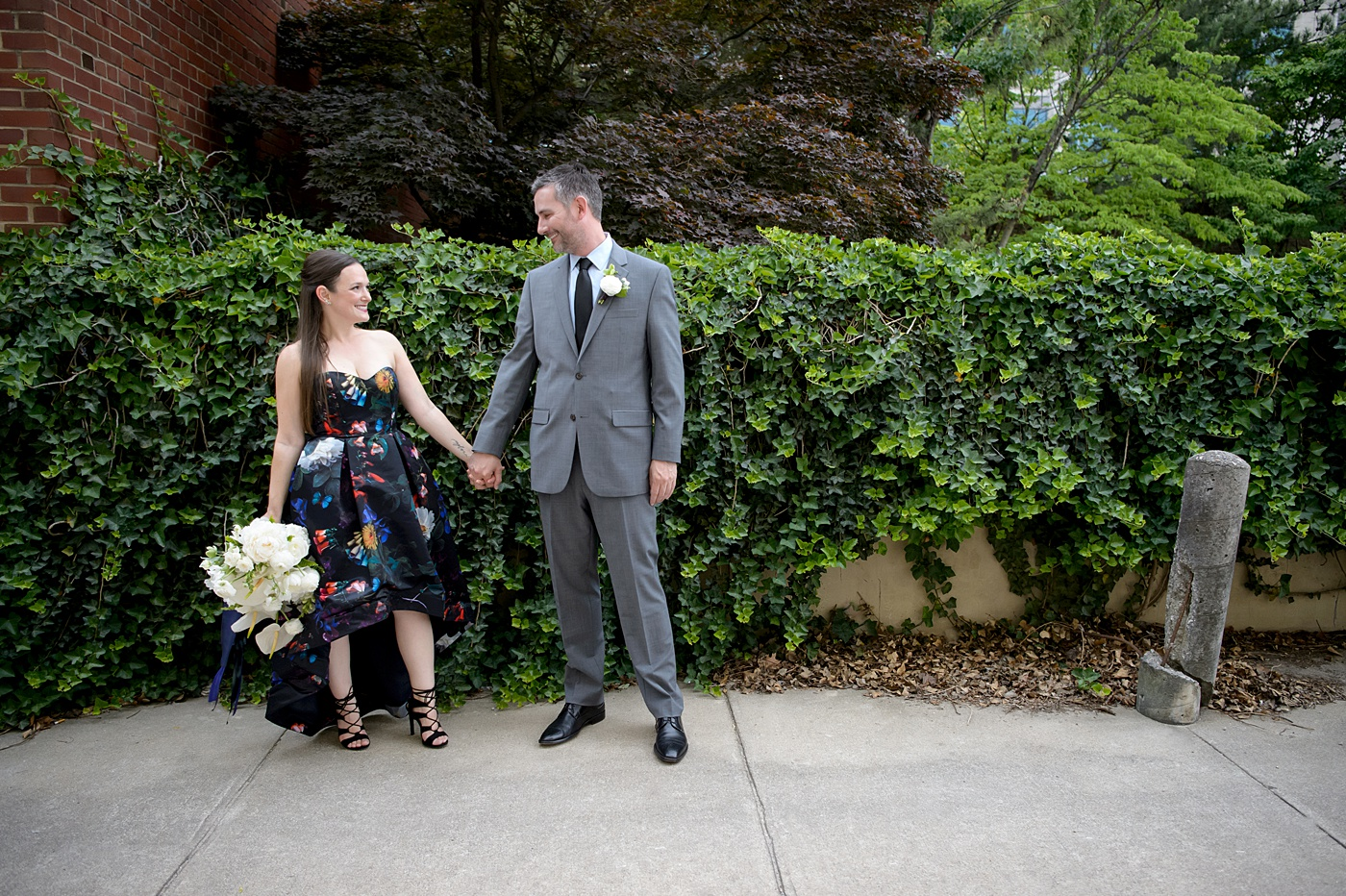 Mikkel Paige Photography's wedding photos - an elopement in downtown Raleigh, North Carolina - with a white bouquet by @meristemfloral, beauty by Wink Hair and Makeup and photos by Brian Mullins Photography.