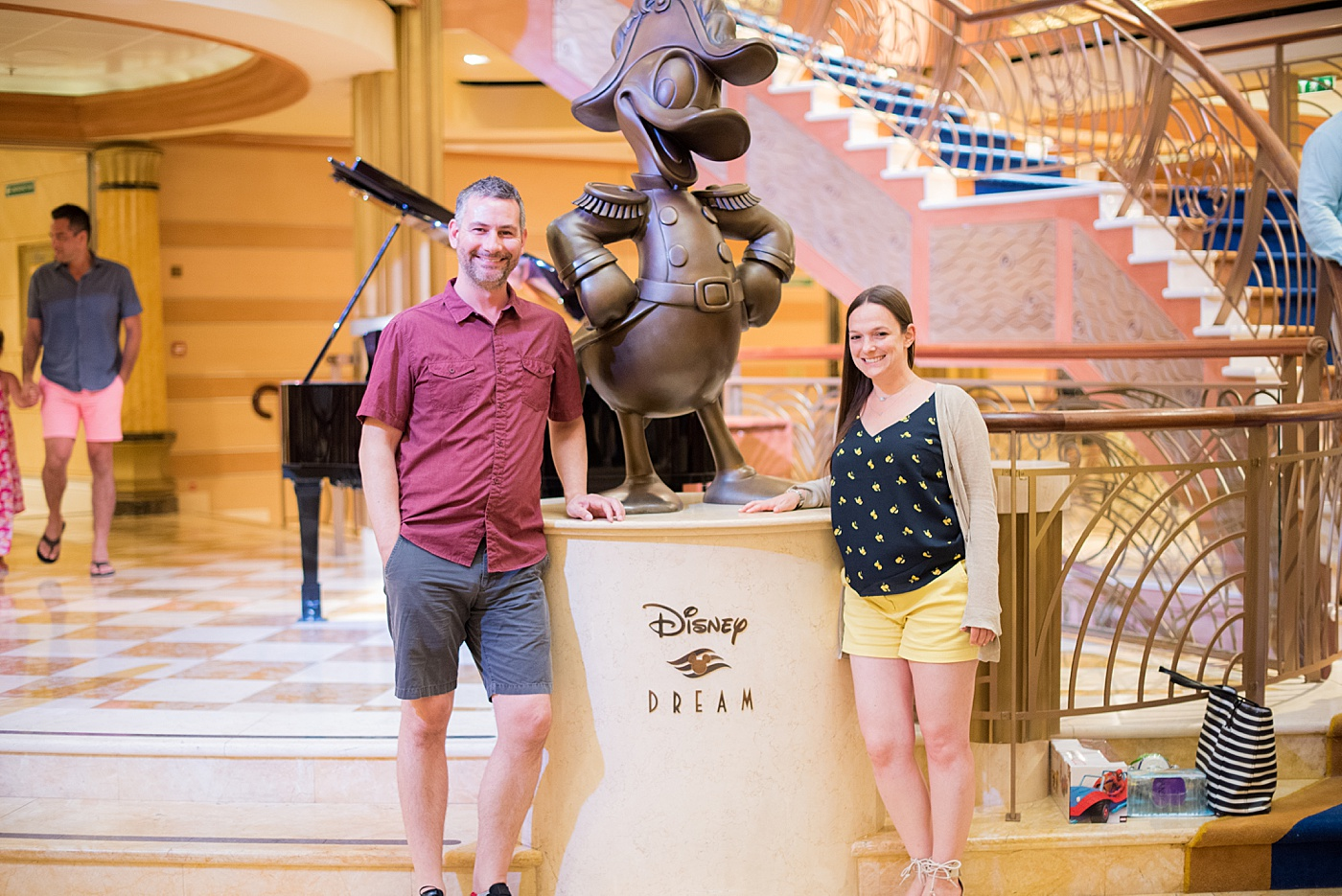 Sometimes Home travel blog owners, Dan and Mikkel, aboard the Disney Dream with Disney Cruise Line. Mikkel was there to photograph a DCL wedding! #SometimesHome #DisneyCruiseLine #DisneyDream