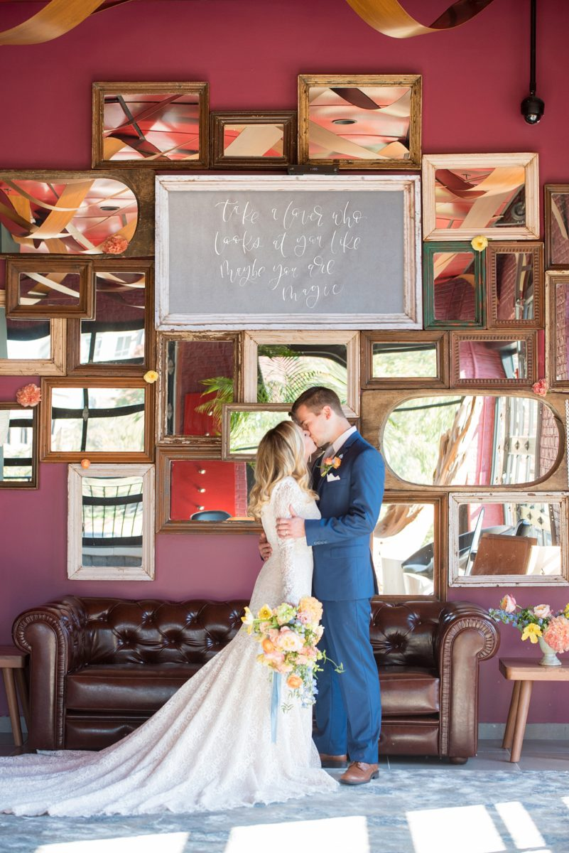 Photos at Vidrio, by Mikkel Paige Photography. This wedding venue in Downtown Raleigh has the brightest of color schemes, a beautiful bridal suite and lots of fun places to photograph a bride and groom any photographer would dream about. They city's stylish restaurant has indoor options for a rehearsal dinner or ceremony and reception in North Carolina. It has wine on tap for your events too! #MikkelPaige #Vidrio #DowntownRaleighWeddingVenue #RaleighWeddingVenue #NorthCarolinaWedding