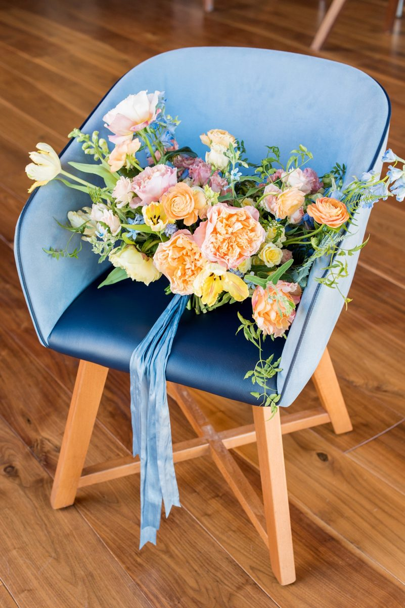 Photos at Vidrio, by Mikkel Paige Photography. This wedding venue in Downtown Raleigh has the brightest of color schemes, a beautiful bridal suite and lots of fun places to photograph a bride and groom any photographer would dream about. They city's stylish restaurant has indoor options for a rehearsal dinner or ceremony and reception in North Carolina. It has wine on tap for your events too! Flowers by @MeristemFloral planning by @magnoliagraceev. #MikkelPaige #RaleighWeddingVenue