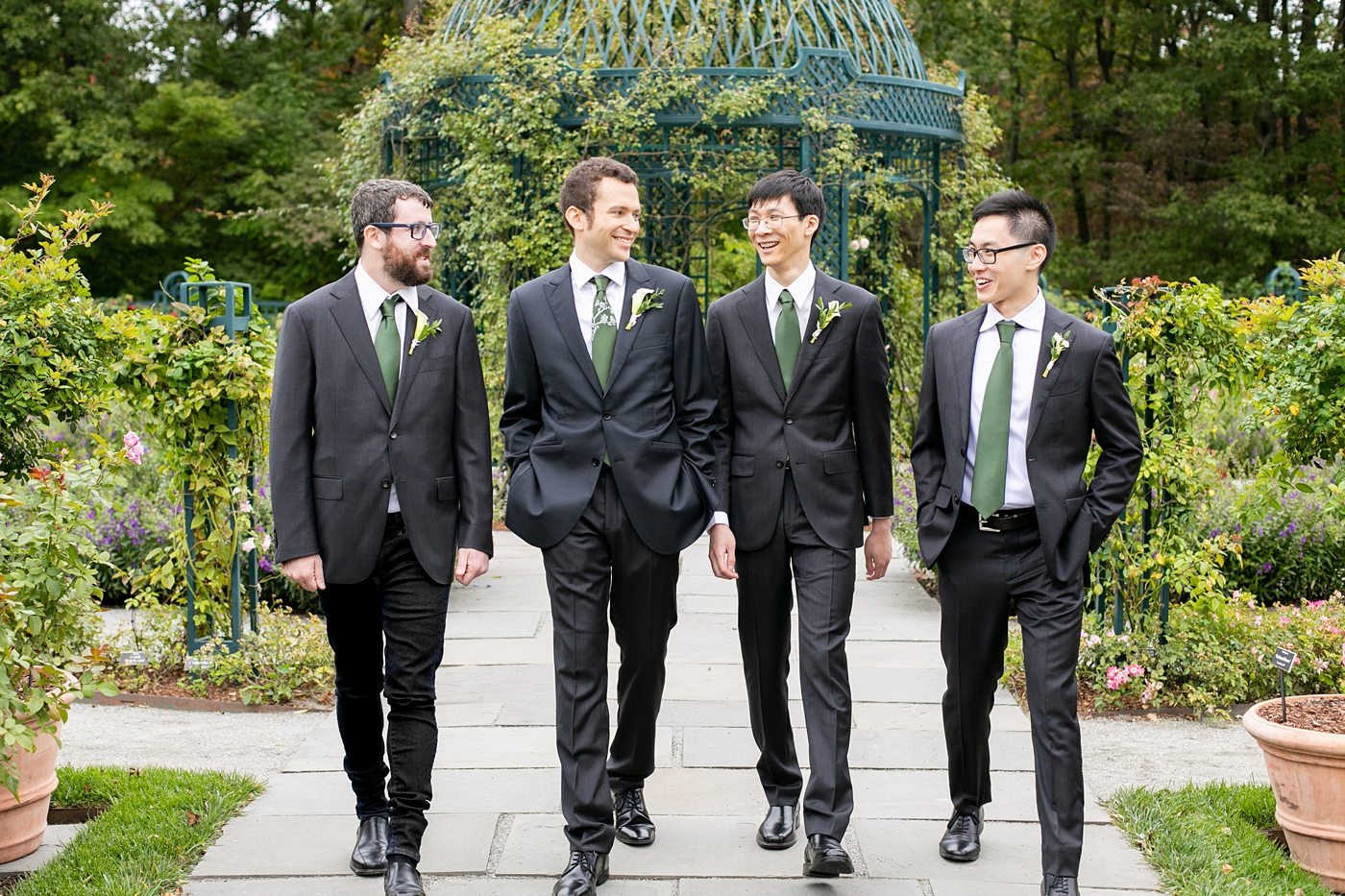 New York Botanical Garden wedding photos with groomsmen in dark gray suits, by Mikkel Paige Photography. After the couple's engagement photoshoot in Manhattan I was so excited for their fall wedding near the Conservatory at the Terrace Room, at this NYC venue. #mikkelpaige #nybg #newyorkbotanicalgardenwedding #NYBotanicalGarden #Bronxwedding #newyorkcityweddingvenues #groomstyle #weddingparty #groomsmen #bridalparty