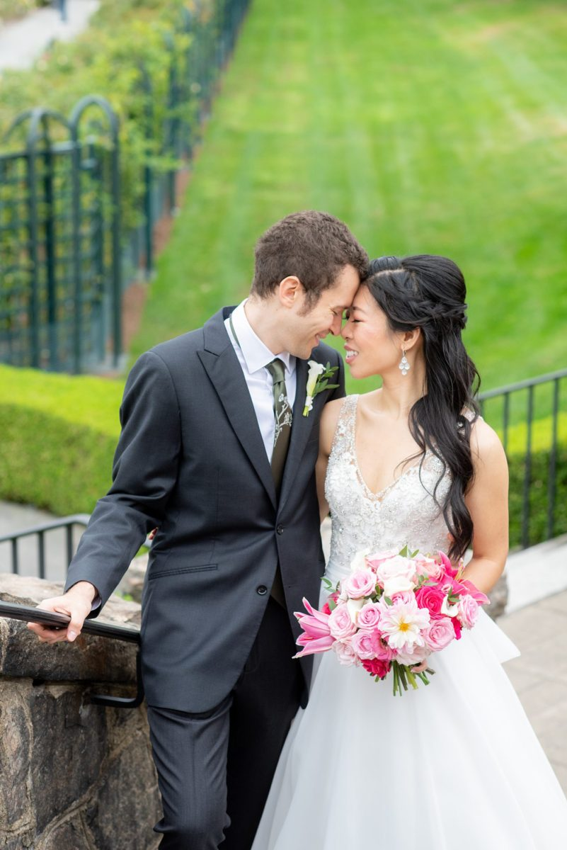 New York Botanical Garden wedding photos by Mikkel Paige Photography. The groom wore a green tie with floral detail and gray suit and bride a beaded ballgown with bow on the back. After the couple's engagement photoshoot in Manhattan I was so excited for their fall wedding near the Conservatory at the Terrace Room, at this NYC venue. #mikkelpaige #nybg #asianbride #bridestyle #brideandgroom #newyorkbotanicalgardenwedding #groomstyle #NYBotanicalGarden #Bronxwedding #newyorkcityweddingvenue