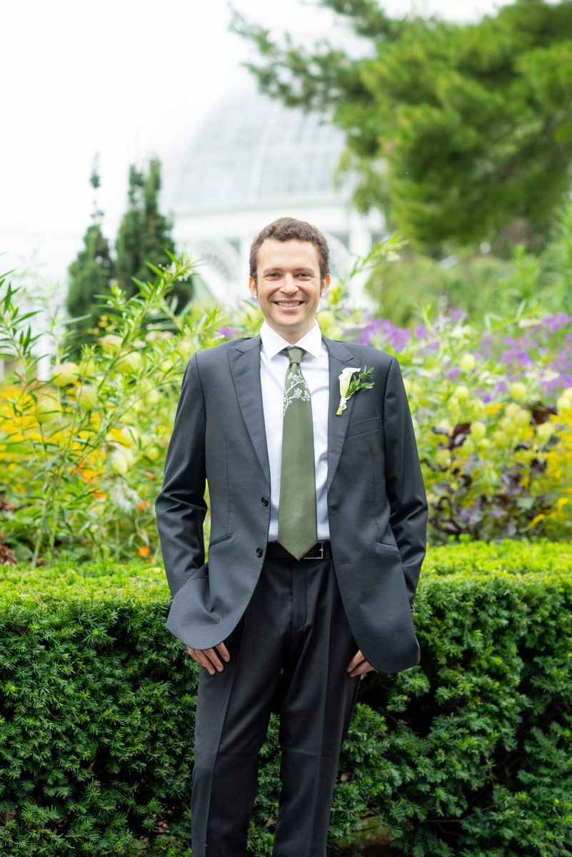 New York Botanical Garden wedding photos by Mikkel Paige Photography. The groom wore a green tie with floral detail. After the couple's engagement photoshoot in Manhattan I was so excited for their fall wedding near the Conservatory at the Terrace Room, at this NYC venue. #mikkelpaige #nybg #newyorkbotanicalgardenwedding #groomstyle #NYBotanicalGarden #Bronxwedding