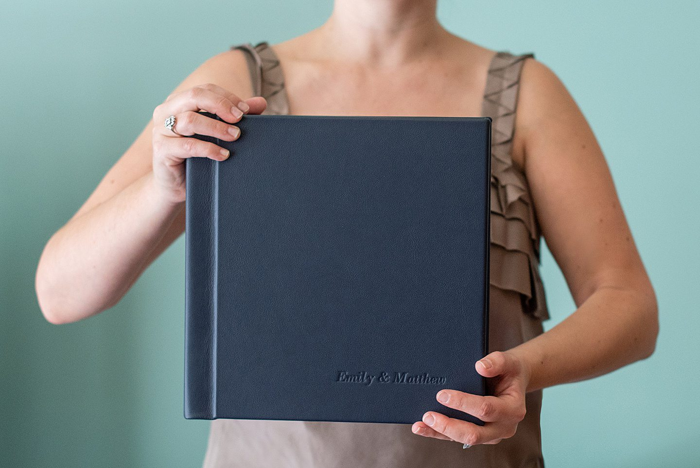 Handmade wedding albums with Mikkel Paige Photography, luxury photographer. Offering fine art keepsake albums.