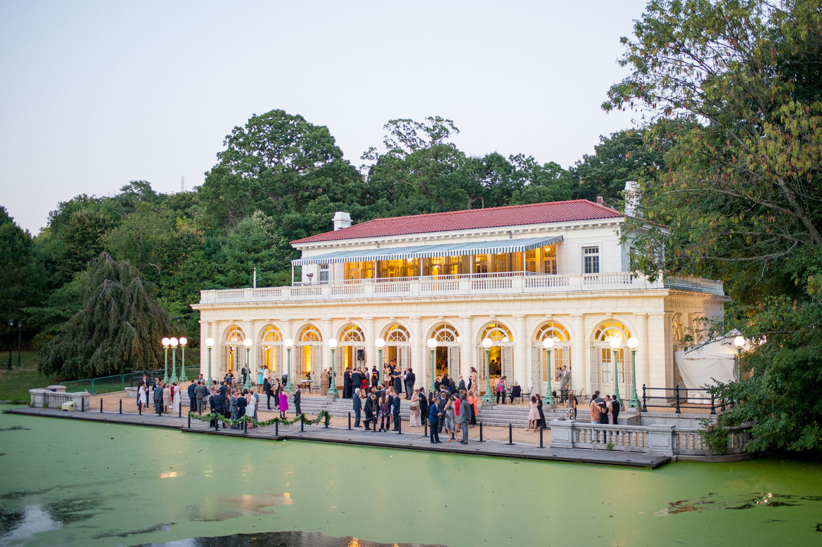 Picture of a luxury wedding at Prospect Park Boathouse lake front venue in Brooklyn. This iconic NYC wedding location is the perfect option to impress guests with its beauty and proximity to Manhattan. Images by Mikkel Paige Photography.