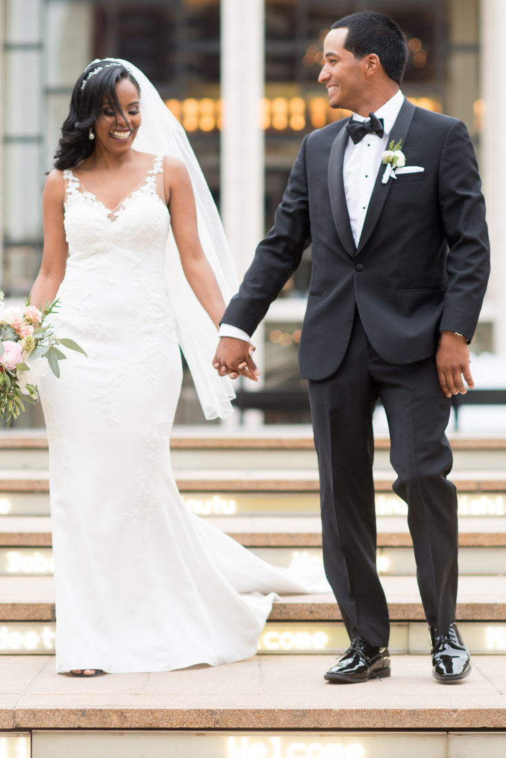 Picture of a bride and groom on their wedding day at Lincoln Center on the west side of Manhattan in NYC. Images by Mikkel Paige Photography.