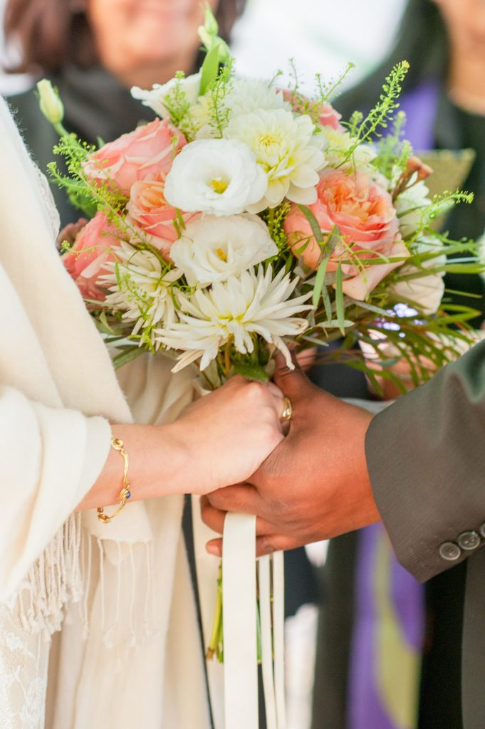 A peach and white bouquet with roses and eucalyptus for a small Brooklyn wedding in NYC during fall with photos by Mikkel Paige Photography.