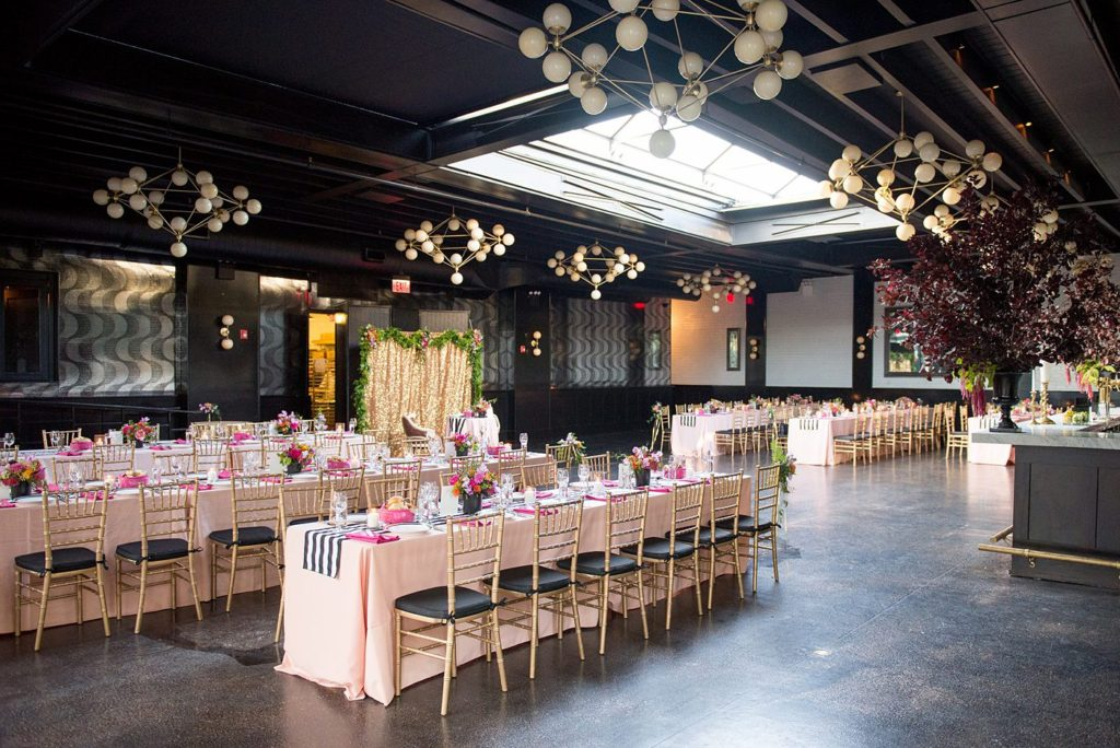 501 Union wedding with photos by Mikkel Paige Photography. The reception in Brooklyn, NY was lined with rectangular tables covered in pink linens, with vibrant flowers by August Sage and Violet and planning by Ashley Chamblin Events.