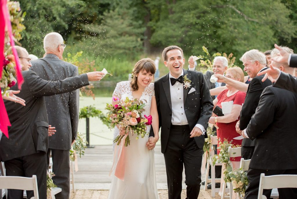 """Mikkel Paige Photography captures a Prospect Park Boathouse wedding in Brooklyn, New York. The bride and groom had classic rice in """"toss me"""" bags for the guests to throw at the ceremony."""