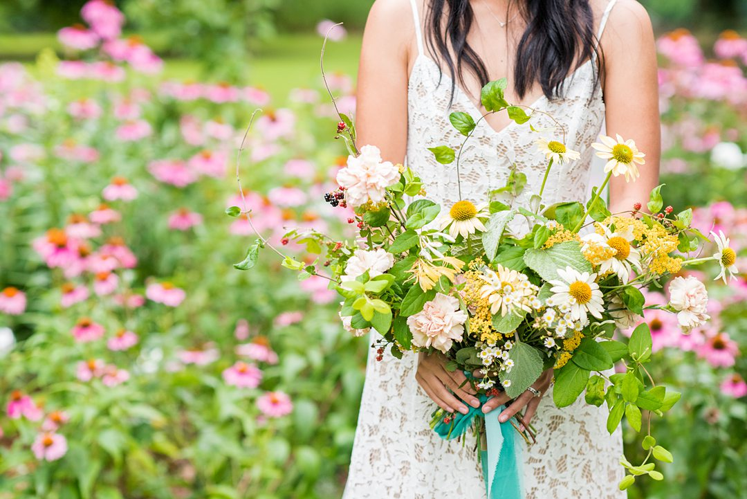 A wildflower bridal bouquet photographed by Mikkel Paige Photography and created by Mood Fleuriste. The couple eloped when COVID-19 changed their original plan.