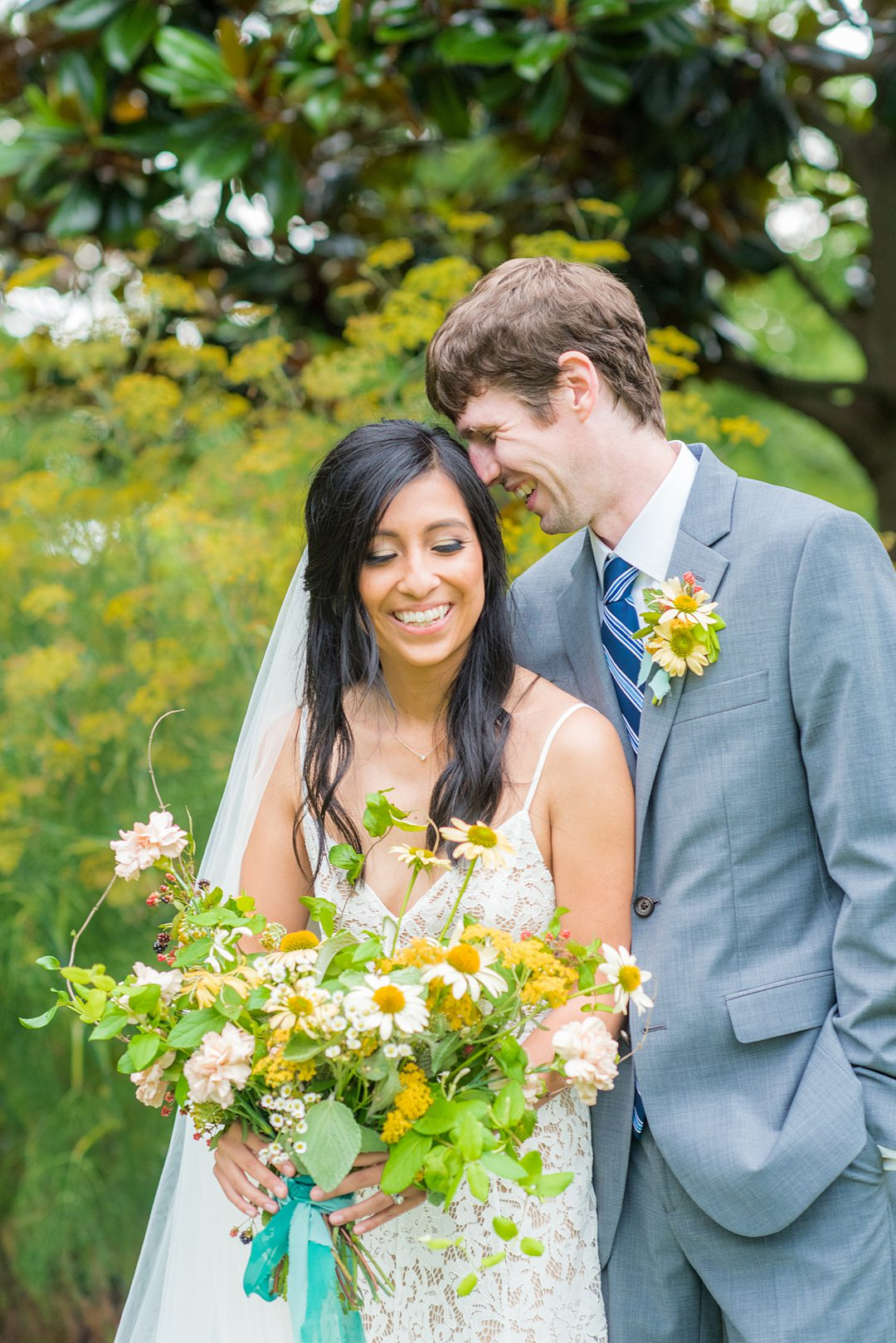The bride and groom eloped and went to the alternative plan when Coronavirus foiled their original wedding. Wildflowers completed an outdoor ceremony in Raleigh, NC photographed by Mikkel Paige Photography. Hair and makeup by Wink, flowers by Mood Fleuriste. #mikkelpaige #raleighelopement #smalloutdoorceremony