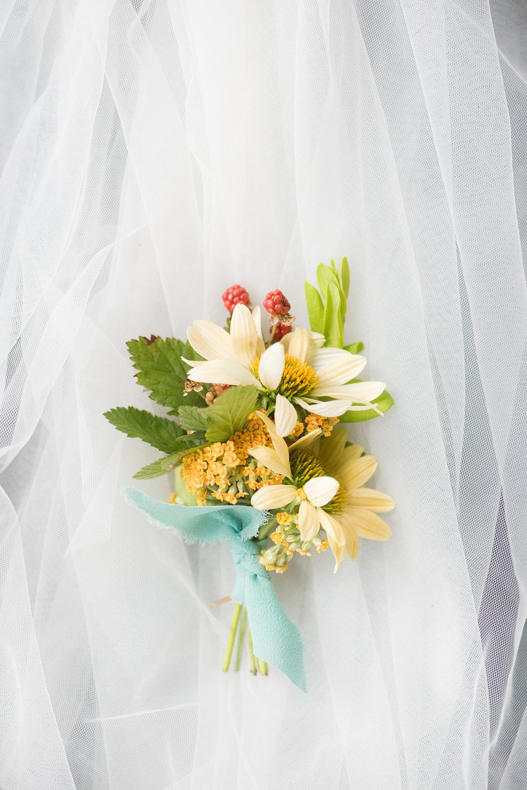A wildflower boutonniere photographed by Mikkel Paige Photography and created by Mood Fleuriste. The couple eloped when COVID-19 changed their original plan.