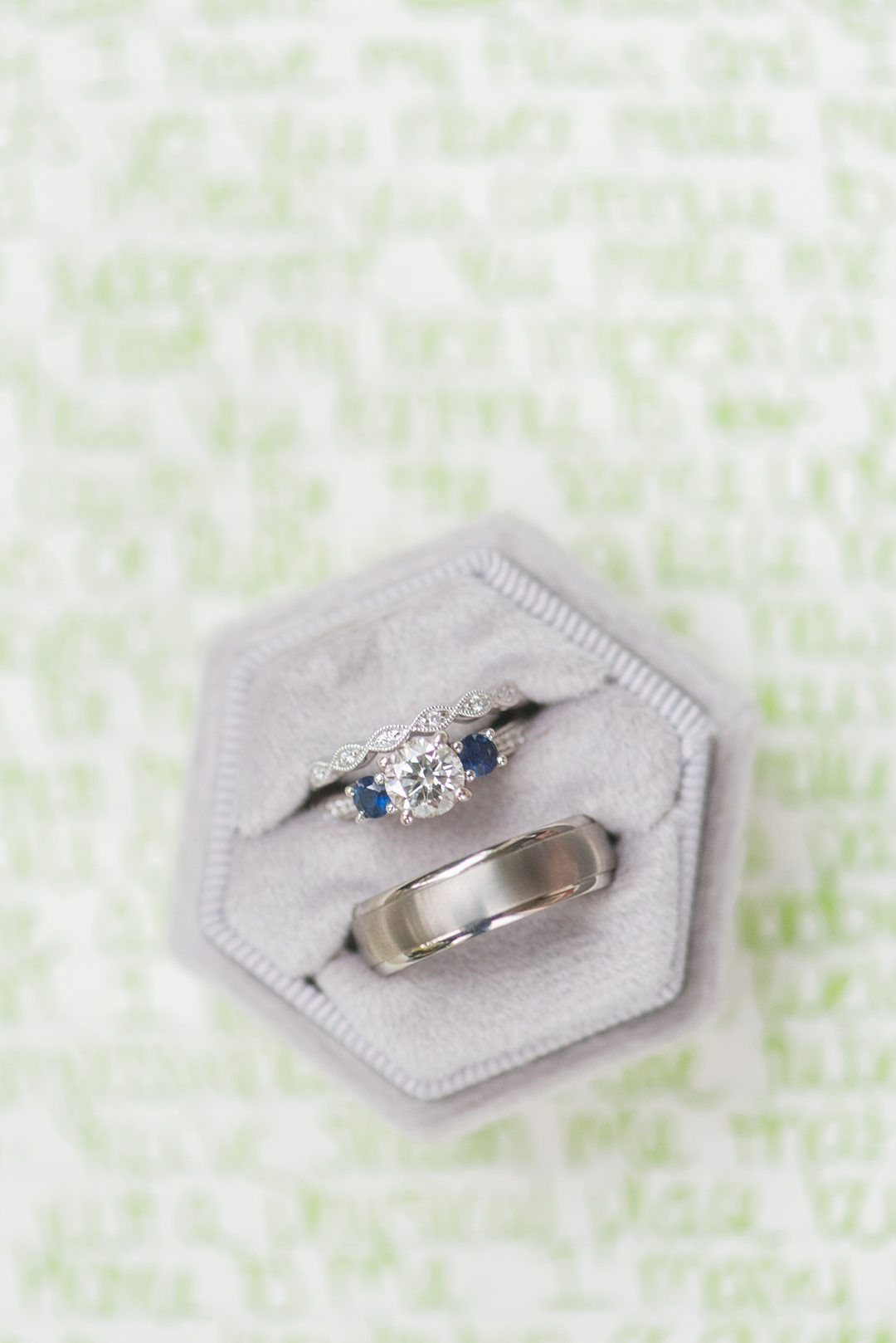 Rings in a grey velvet ring box captured by Mikkel Paige Photography. The detail photo was part of a small outdoor ceremony in Raleigh, NC.