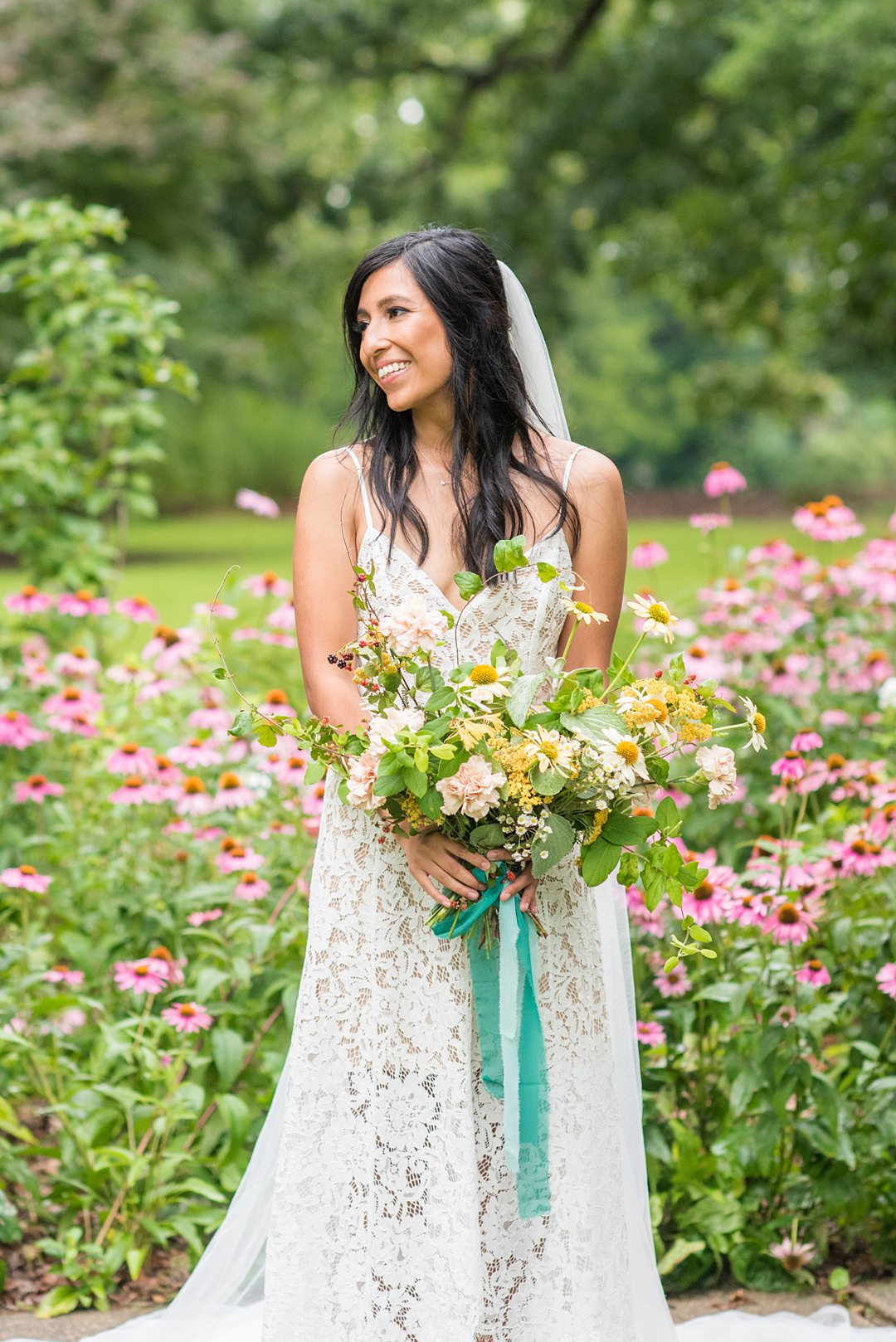 The bride after her small outdoor ceremony in a park in Raleigh, North Carolina. Photographed by Mikkel Paige Photography, hair and makeup by WINK and flowers by Mood Fleuriste. #mikkelpaige #bride #wildflowerbouquet #raleighnc