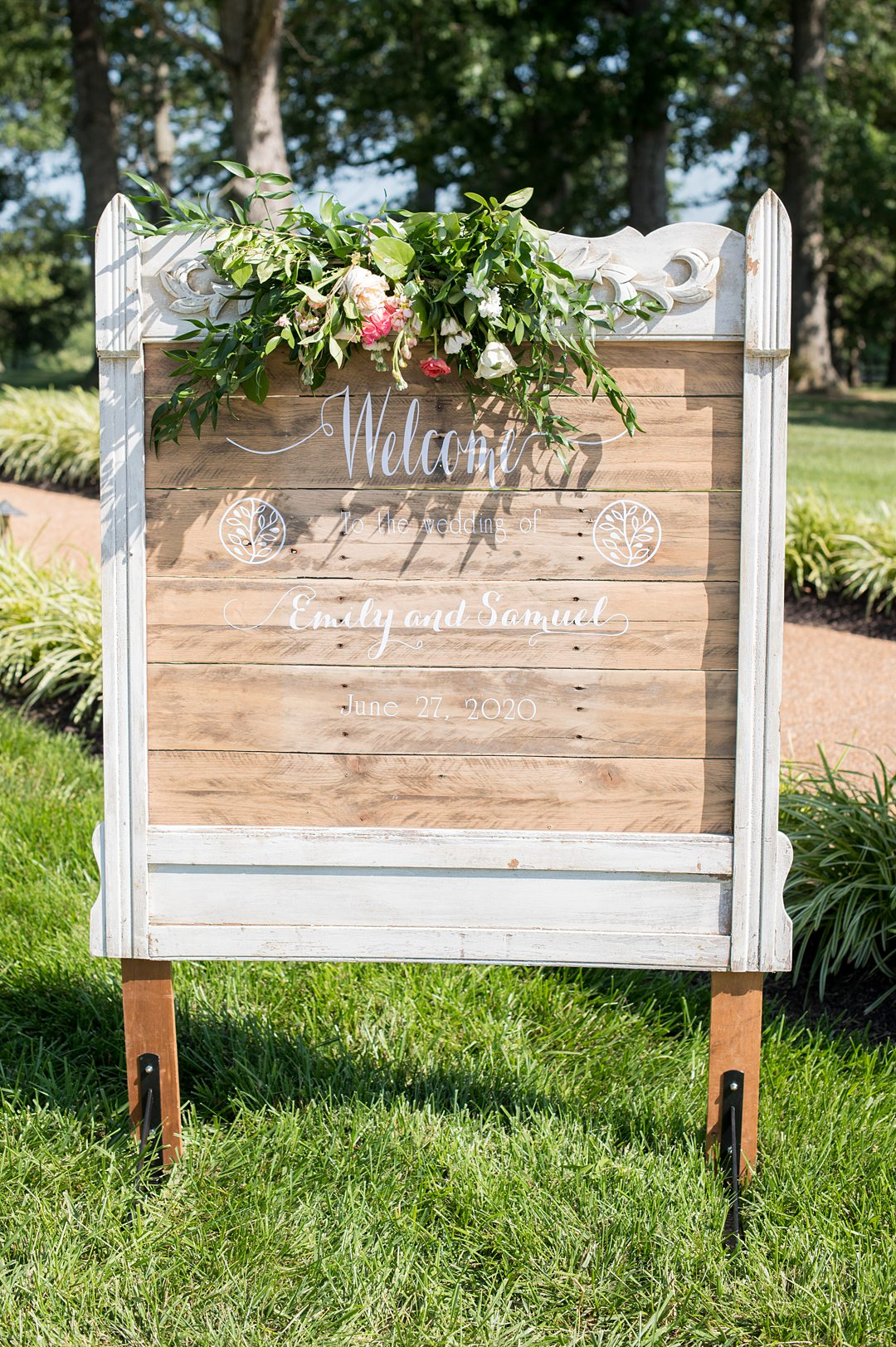 The wedding welcome sign with script letters on a custom wood frame for a small wedding at The Lodge at Mount Ida Farm overlooking the Blue Ridge Mountains. Photographed by Mikkel Paige Photography.