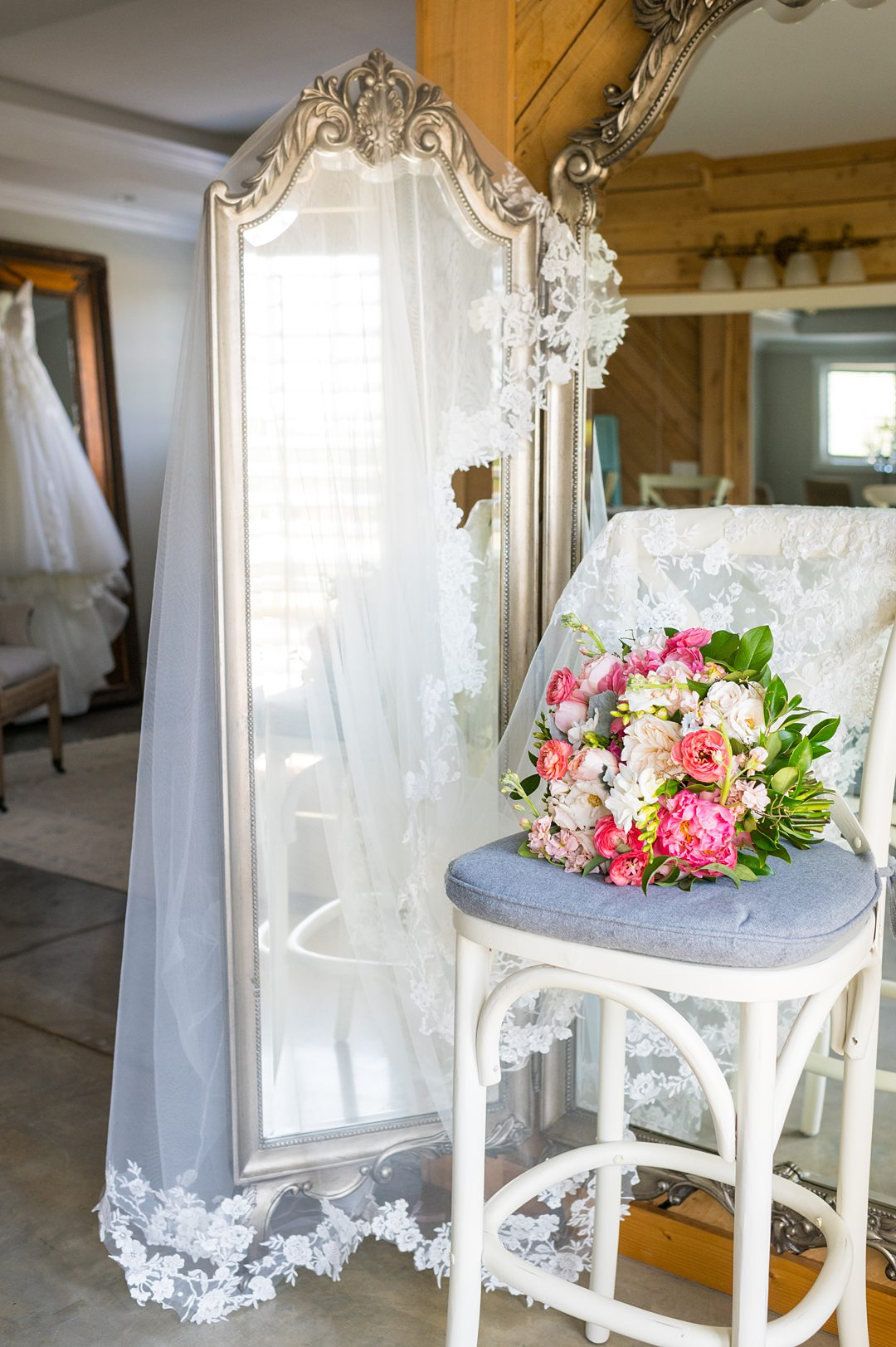 A bouquet, veil and wedding gown at the Bridal Suite at The Lodge at Mount Ida Farm. Photos by Mikkel Paige Photography and planning by Mary Elizabeth Events.